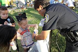 child interacting with police officer at National Night Out
