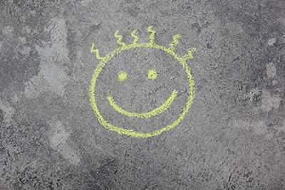 chalk drawing of smiley face