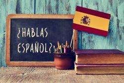 Chalkboard with Hablas Espanol, Books, Pencils, Flag