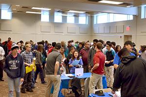 Teens meeting employers at the Teen Job Pfair